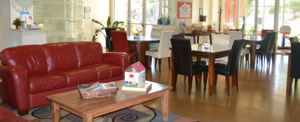 Dining room with tables, couches and chairs at the Ronald McDonald House