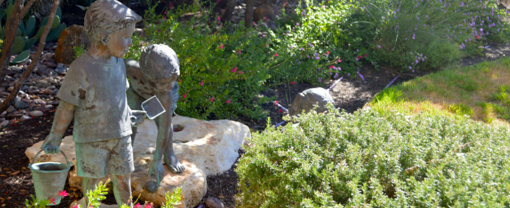 Healing Hearts garden with bronze statues of children