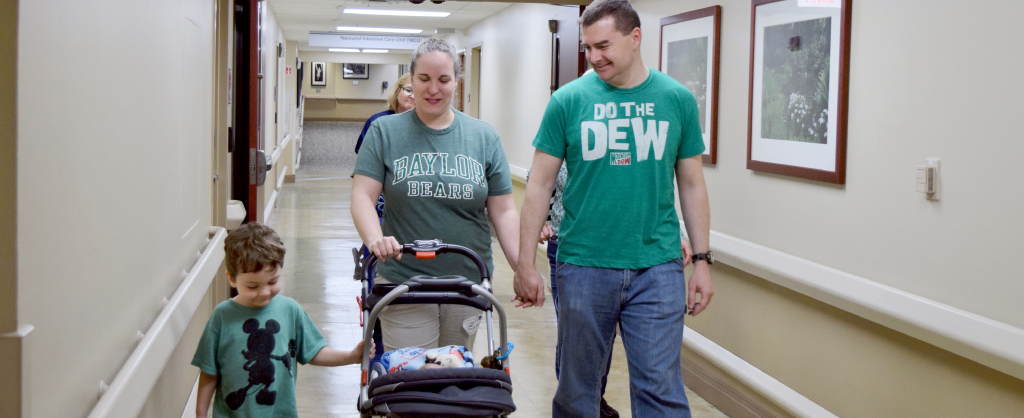 Dawalt Family walking down hospital hallway together as they take baby Wesley home.