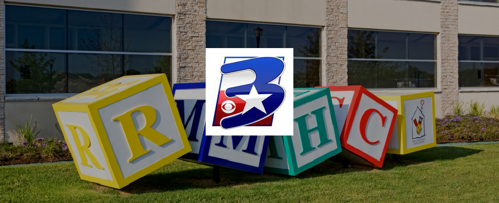 KNTX Media Logo overlaid on image of the RMHC blocks sculpture