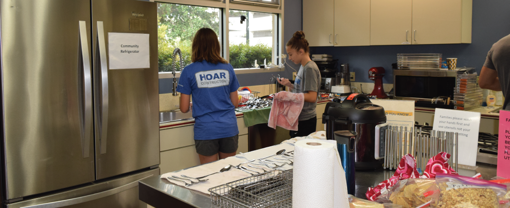 Children of Hoar Construction employees help in the kitchen refresh project at Ronald McDonald House