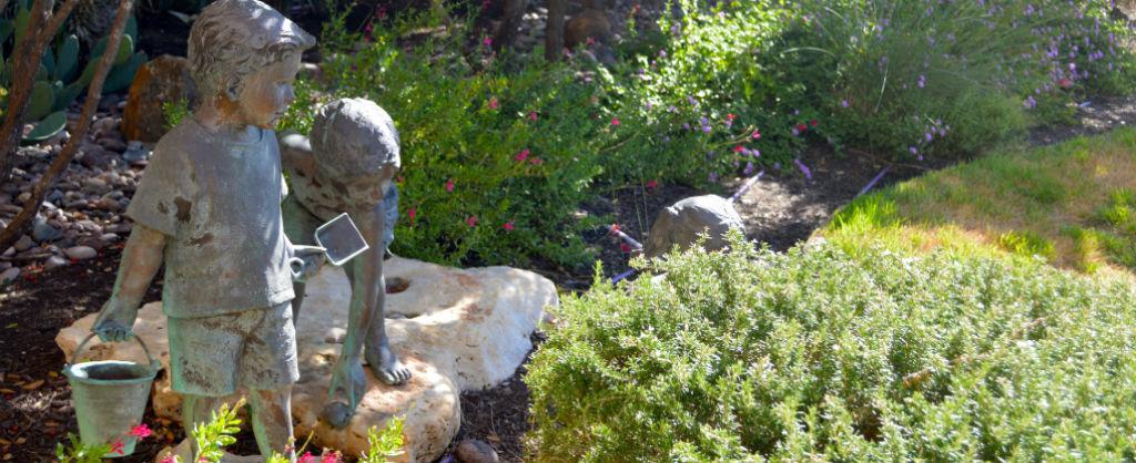 Healing Hearts garden with bronze statues of children