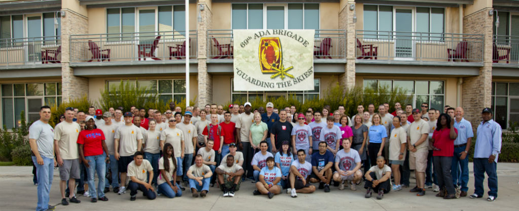 Incredibly large group of people pose for in rows in front of the Ronald McDonald House