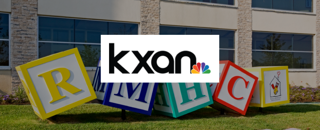 KXAN Logo over image of RMHC block statues