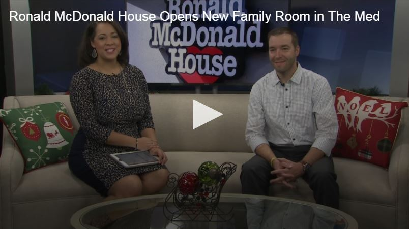 Video still of news interview with Tanner Williams and news reporter discussing new Ronald McDonald Family Room