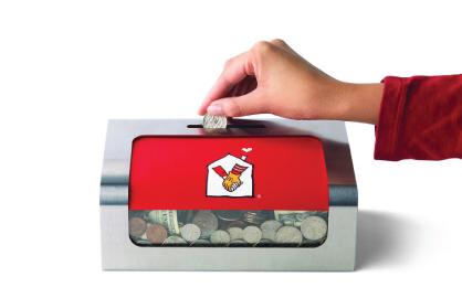 hand placing change into mcdonalds donation box