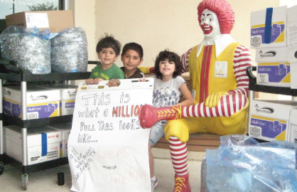 three children with one million soda can pull tabs for donation to RMHC of central Texas