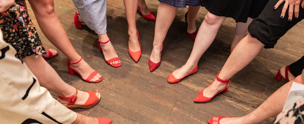 Wearing red shoes for the event